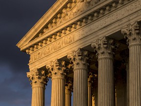 FILE - In this Oct. 10, 2017, file photo, the Supreme Court in Washington is seen at sunset. The Supreme Court is hearing arguments in a free speech fight over California's attempt to regulate anti-abortion crisis pregnancy centers. The case being argued March 20, 2018, involves information required by a state law that the centers must provide clients about the availability of contraception, abortion and pre-natal care, at little or no cost. Centers that are unlicensed also must post a sign that says so.