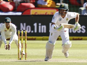 South Africa's Dean Elgar makes a run on the second day of the second cricket test between South Africa and Australia at St. George's Park in Port Elizabeth, South Africa, Saturday, March 10, 2018.