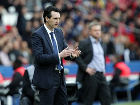 PSG headcoach Unai Emery reacts after PSG's Thomas Meunier scored a goal during the French League One soccer match between Paris Saint-Germain and Metz at the Parc des Princes Stadium, in Paris, France, Saturday, March 10, 2018.