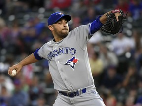 Toronto Blue Jays starting pitcher Marco Estrada works against the Texas Rangers during the first inning of a baseball game Friday, April 6, 2018, in Arlington, Texas.