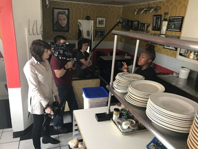 "Director Maya Gallus, left, talks to chef Suzanne Barr, right, during filming of the documentary ""The Heat: A Kitchen (R)evolution"" in this undated handout photo. In making a documentary about top female chefs, Toronto filmmaker Maya Gallus noticed an ironic theme emerge. ""Women were fighting for years to get out of the kitchen and now women are fighting to get their rightful place back in the kitchen,"" she said in an interview. ""The Heat: A Kitchen (R)evolution,"" which opens the Hot Docs Canadian International Documentary Festival on Thursday, details the gender barriers women have faced in climbing the ranks of the professional culinary world."