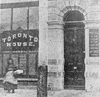 The only known photo of Toronto House, better known as Trotter's Boarding House. A plaque marks the spot where Thomas D'Arcy McGee was assassinated earlier that year. The building was destroyed by fire in January 1869.
