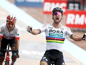 Slovakia's Peter Sagan celebrates after winning the 116th edition of the Paris-Roubaix cycling classic, a 257,5 kilometer (160 mile) one day race, with about 20 per cent of the distance run on cobblestones, at the velodrome in Roubaix, northern France, on Sunday, April 8, 2018. Switzerland's Silvan Dillier finishes second.