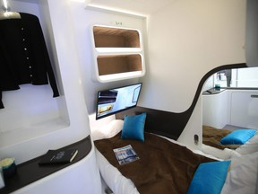 A bed and wardrobe sit inside a Airbus A350 'Day and Night' passenger jet cabin on the Airbus SE exhibition stand at the Aircraft Interiors Expo in Hamburg, Germany, on Wednesday, April 11, 2018.