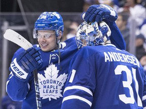 Auston Matthews, left,  congratualtes Frederik Andersen after the Toronto Maple Leafs defeated the Montreal Canadiens to end the regular season on Saturday night.