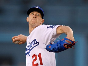Los Angeles Dodgers starting pitcher Walker Buehler throws to the plate during the first inning of a baseball game against the Miami Marlins Monday, April 23, 2018, in Los Angeles.