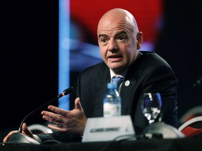 FILE- In this file photo dated Thursday, April 12, 2018, FIFA President Gianni Infantino speaks during the annual conference of the South American Football Confederation, CONMEBOL, in Buenos Aires, Argentina.  Speaking about the upcoming vote to name the host country for the 2026 World Cup, Infantino insists he is impartial.