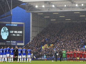 Everton and Liverpool players hold a minute's silence in memory of the late Ray Wilkins before the Premier League soccer match between Everton and Liverpool at Goodison Park, Liverpool England. Saturday, April 7, 2018.