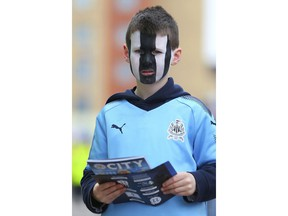 A young Newcastle United fan wears facepaint ahead of the English Premier League soccer match between Leicester City and Newcastle at the King Power stadium, Leicester, England. Saturday, April 7, 2018
