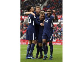 Tottenham Hotspur's Christian Eriksen, center, celebrates scoring his side's first goal of the game with his team-mates during the English Premier League soccer match between Stoke City and Tottenham Hotspur at the bet365 Stadium Stoke, England. Saturday, April 7, 2018, 2018.
