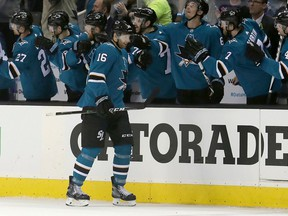 FILE - In this April 16, 2018, file photo, San Jose Sharks center Eric Fehr (16) is congratulated by teammates after scoring a goal against the Anaheim Ducks during the second period of Game 3 of an NHL hockey first-round playoff series in San Jose, Calif. Fehr and Marcus Sorensen spent most of the season toiling in the AHL, just waiting for their chance. That opportunity has arrived in the playoffs for San Jose and those two fourth-line forwards are a major reason why the Sharks swept Anaheim to advance to a second-round series against Vegas. Fehr scored one goal while anchoring the fourth line and Sorensen had three as San Jose's bottom group of forwards that also includes Melker Karlsson matched the scoring output of the entire Anaheim team in the series.