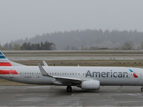 FILE- In this April 13, 2018, file photo, an American Airlines plane taxis Friday, April 13, 2018, at the Seattle-Tacoma International Airport in Seattle. American Airlines reports earns on Thursday, April 26.