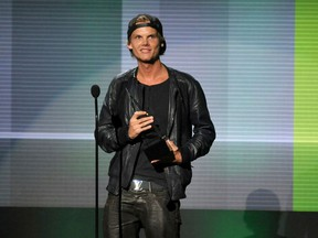 """FILE - In this Nov. 24, 2013 file photo, Avicii accepts the award for favorite artist - electronic dance music at the American Music Awards in Los Angeles. Avicii's family released a statement Monday, April 23, 2018, saying they """"would like to thank you for the support and the loving words about our son and brother."""" They say they are grateful for his fans around the world who loved his music. Swedish-born Avicii, whose name is Tim Bergling, was found dead, April 20, in Muscat, Oman. He was 28."""
