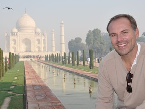 """This undated photo shows John DiScala, better known as the air travel expert Johnny Jet, at the Taj Mahal in Agra, India. DiScala offered tips and strategies for booking flights and getting the best deals for summer travel in an interview with the AP Travel podcast """"Get Outta Here!"""" airing Wednesday, April 25."""