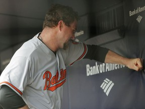Baltimore Orioles starting pitcher Mike Wright Jr. punches a wall after allowing five runs during the first inning of a baseball game against the New York Yankees in New York, Sunday, April 8, 2018.
