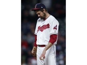 Cleveland Indians' Andrew Miller reacts after having thrown only two pitches against the Chicago Cubs during the seventh inning in a baseball game Wednesday, April 25, 2018, in Cleveland. Miller had to leave the game.