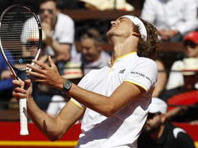 Germany's Alexander Zverev reacts during his match against Spain's Rafael Nadal during a World Group Quarter final Davis Cup tennis match between Spain and Germany at the bullring in Valencia, Spain, Sunday April 8, 2018.
