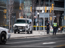 Police guard a damaged van after a driver drove into Toronto pedestrians on Monday, killing at least 10.