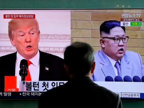 In this March 27, 2018, file photo, a man watches a TV screen showing file footages of U.S. President Donald Trump, left, and North Korean leader Kim Jong Un during a news program at the Seoul Railway Station in Seoul, South Korea.
