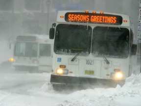 A couple of Metro Transit buses get stuck near the corner of Spring Garden and Barrington Streets. Metro Transit later pulled its buses from the road due to bad road conditions. A decision released Tuesday said management at the Halifax Transit maintenance yard allowed a bully who made racist statements to run rampant in the workplace.