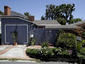 This tiny cottage on Lombardy Lane in Laguna Beach, Calif. is for sale at just shy of $1 millions is shown Friday, May 25, 2018. This one bedroom home is 595 square feet and is a few blocks from the ocean.