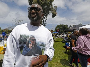 """Aloysius McMahan from Oakland made a shirt representing the reason why he and many others in the Black community were at Lake Merritt in Oakland, Calif., barbecuing at the """"BBQ-ing while Black"""" event at the lake off Lakeshore Avenue on Sunday, May 20, 2018. Hundreds in the African American community came out to Lake Merritt in response to a confrontation caught on video a few weeks ago when someone complained to police about a group of black people barbecuing."""