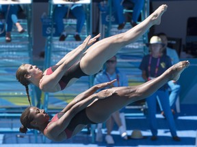 Canada's Jennifer Abel, front, and Melissa Citrini-Beaulieu perform in the women's 3m synchro springboard final at the Commonwealth Games in Gold Coast, Australia, on April 11.