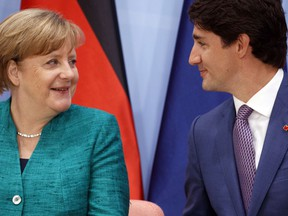 German Chancellor Angela Merkel talks with Canadian Prime Minister Justin Trudeau during the Women's Entrepreneurship Finance event at the G20 Summit, in Hamburg, Germany, Saturday, July 8, 2017.