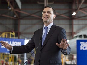 """Ontario PC Leader Tim Hudak addresses the media in Mississauga, Ontario on Thursday, June 12, 2014. The president of Toronto's real estate board warned leaders of the Ontario Real Estate Association, headed by a former Progressive Conservative leader, to """"stay in their lane"""" in an emphatic letter that lays out concerns that the provincial organization is stoking fears about the housing market and becoming too political."""