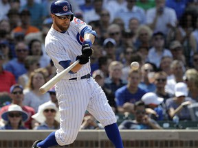 Chicago Cubs' Ben Zobrist hits a two-run double off San Francisco Giants relief pitcher Will Smith during the seventh inning of a baseball game Friday, May 25, 2018, in Chicago. Ian Happ and Javier Baez scored on the play.