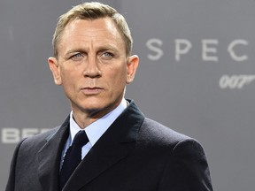 British actor Daniel Craig poses for photographers at a photocall for the new James Bond film 'Spectre' on October 28, 2015 in Berlin.