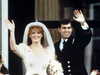 Prince Andrew, the Duke of York and his wife Sarah Ferguson, the Duchess of York on their wedding day. They remain close despite divorcing in 1996.