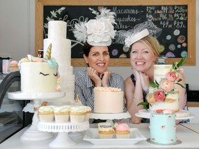 Le Dolci bakery owner Lisa Sanguedolce, left, and general manager Danielle Ellis, are promoting a selection of royal-inspired desserts in Toronto, ahead of Prince Harry's wedding to Meghan Markle, Tuesday, May 8, 2018.