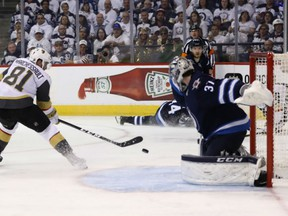 Jonathan Marchessault of the Vegas Golden Knights scores the second of his two goals on the night past Connor Hellebuyck of the Winnipeg Jets during Game 2 action in the Western Conference final Monday in Winnipeg. The Golden Knights won 3-1 to tie the series at 1-1 heading to Vegas for the next two games.