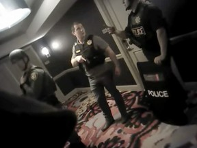 This photo from police officer video body camera footage on Oct. 1, 2017, provided by the Las Vegas Metropolitan Police Department, shows officers searching hallways during the deadliest mass shooting in modern U.S. history by Stephen Paddock, at the Mandalay Bay Hotel in Las Vegas, released Wednesday, May 2, 2018.