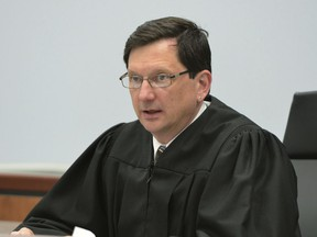 FILE - In this March 21, 2016, file photo, Judge Thomas Estes presides in Eastern Hampshire District Court in Belchertown, Mass. The Supreme Judicial Court said Thursday, May 24, 2018, that Estes would be suspended without pay effective June 15. Estes admitted to having an affair with a clinical social worker that included sexual encounters at the courthouse.