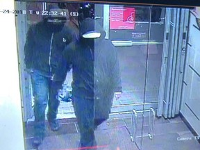 Police are now searching for two males caught on security camera, shown in this police handout image, who they say fled the scene immediately after an explosion at a restaurant in Mississauga.