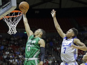 FILE - In this July 3, 2017, file photo, Boston Celtics forward Jayson Tatum (11) lays the ball in as Philadelphia 76ers guard Markelle Fultz (7) defends during an NBA summer league basketball game in Salt Lake City. The Celtics have a 1-0 Eastern Conference semifinal lead over Philadelphia. And Tatum, who was selected third by Boston 11 months ago, has been a revelation on a team battered by injuries. Fultz is not having nearly as much fun. He has been reduced to a spectator after a down regular season that saw him go through shooting issues and miss 68 games with a shoulder injury.