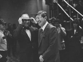 FILE - In this Nov. 20, 1986, file photo, New York Islanders general manager Bill Torrey, left, and former Islanders coach Al Arbour grin as Torrey mimics Arbour's glasses during ceremonies honoring Arbour at the Nassau Coliseum in Uniondale, N.Y. Torrey, the general manager of the New York Islanders when they won four consecutive Stanley Cups in the 1980s and the first president of the Florida Panthers, died Thursday, May 4, 2018. The Panthers and the NHL announced Torrey's death. He was 83.
