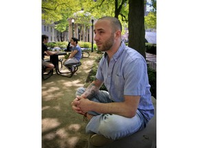 In this May 9, 2018 photo, Iraq War veteran Kristofer Goldsmith, sits in a campus park after his last final exam of the semester at Columbia University in New York. Military veterans with less-than-honorable discharges from the military say they often can't get jobs, and they hope a recent warning to employers by the state of Connecticut will change that. Goldsmith says that for veterans with bad paper, their service record looks more like a criminal record to potential employers.