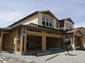 FILE- This May 4, 2018, file photo shows a house is under construction in Roseville, Calif. On Wednesday, May 23, the Commerce Department reports on sales of new homes in April.