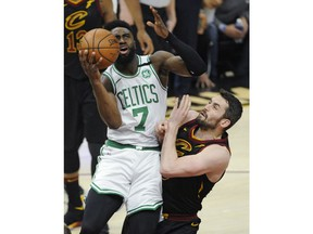 Boston Celtics' Jaylen Brown (7) drives to the basket against Cleveland Cavaliers' Kevin Love during the first half of Game 6 of the NBA basketball Eastern Conference finals Friday, May 25, 2018, in Cleveland.