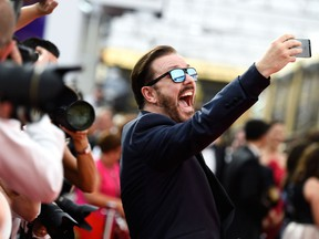 Ricky Gervais takes a selfie at the Emmy Award on September 20, 2015 in Los Angeles, California.