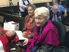 In this May 16, 2018 photo, Cathy Jordan, right, who has been suffering from ALS since 1987, looks on after completing testimony in Tallahassee, Fla., that would declare a smoking ban on medical marijuana unconstitutional in Florida. A Florida judge on Friday, May 25, 2018, ruled that the ban is unconstitutional.