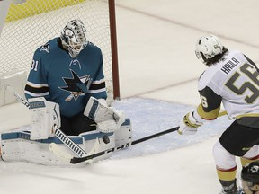 San Jose Sharks goalie Martin Jones (31) defends against a shot by Vegas Golden Knights left wing Erik Haula (56), from Finland, during the third period of Game 4 of an NHL hockey second-round playoff series in San Jose, Calif., Wednesday, May 2, 2018. The Sharks won 4-0.