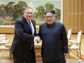 In this Wednesday, May 9, 2018, file photo provided by the North Korean government, U.S. Secretary of State Mike Pompeo, left, shakes hands with North Korean leader Kim Jong Un during a meeting at Workers' Party of Korea headquarters in Pyongyang, North Korea.