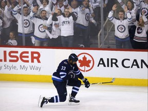 Winnipeg Jets defenceman Dustin Byfuglien celebrates his goal against the Nashville Predators during Game 2 of their second-round playoff series in Winnipeg on Tues., May 1, 2018.