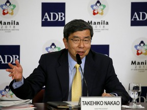 Takehiko Nakao, President of Asian Development Bank, Asia's premier lending institution, gestures during a news conference at the ongoing 51st ADB Annual Governor's Meeting Thursday, May 3, 2018 in suburban Mandaluyong city northeast of Manila, Philippines. The Asian Development Bank's chief says trade in Asia, growing at a fast clip since 2017, could be disrupted if disputes escalate.