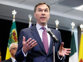 Finance Minister Bill Morneau speaks to reporters after a meeting with provincial and territorial finance ministers in Ottawa on June 26, 2018.