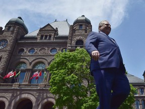 Doug Ford walks out onto the front lawn of the Ontario Legislature at Queen's Park in Toronto on June 8, 2018.